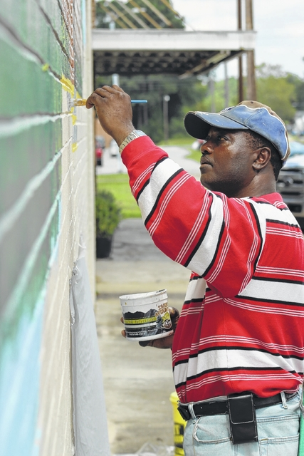 Sampson independent robert hall creates mural project for Brooks brothers garland shirt factory